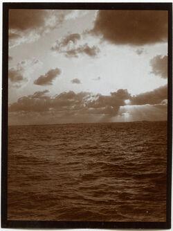Fotografie Sonnenuntergang über Alexandrien [Alexandria] v. Meer